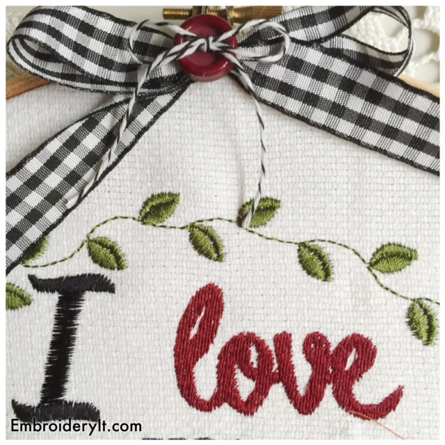 Machine embroidered word decor love you more than