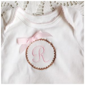 Machine Embroidered monogram baby onesie
