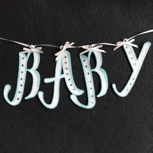 Machine embroidery free standing lace baby banner