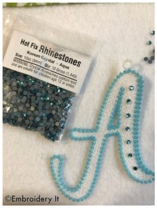 Rhinestones added to machine embroidery